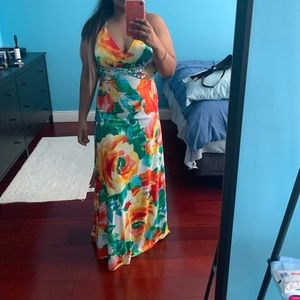 Floral floor length dress, criss-cross back.